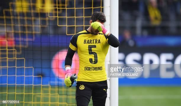 Dortmund's Swiss goalkeeper Roman Buerki wears a shirt for his injured teammates defender Marc Bartra as he warms up prior to the UEFA Champions...