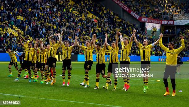 Dortmund's team celebrates after the German first division Bundesliga football match between Borussia Dortmund and TSG 1899 Hoffenheim on May 6 2017...