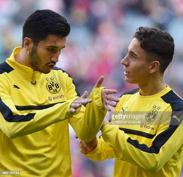 Dortmund's Turkish midfielder Emre Mor and Dortmund's Turkish midfielder Nuri Sahin chat prior to the German first division Bundesliga football match...