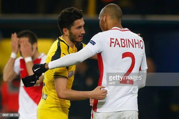 Dortmund's Turkish midfielder Nuri Sahin and Monaco's Brazilian defender Fabinho embrace after the UEFA Champions League 1st leg quarterfinal...