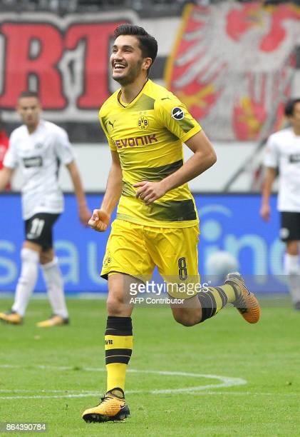 Dortmund's Turkish midfielder Nuri Sahin celebrates after scoring the first goal during the German First division Bundesliga football match Eintracht...