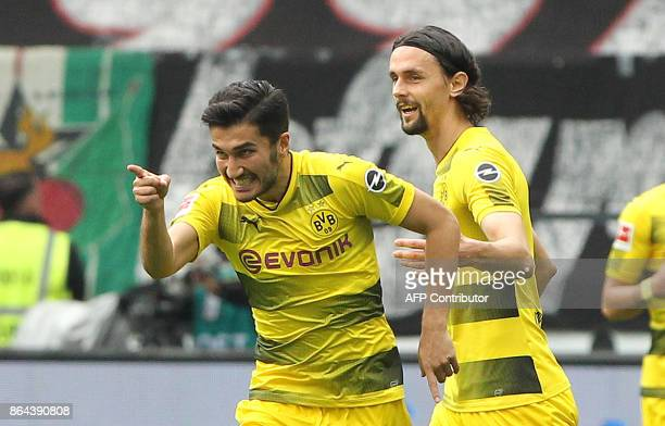 Dortmund's Turkish midfielder Nuri Sahin celebrates after scoring the first goal during the German First division Bundesliga football match Eintracht...