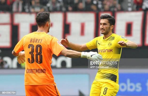 Dortmund's Turkish midfielder Nuri Sahin celebrates with his teammate after scoring the first goal during the German First division Bundesliga...