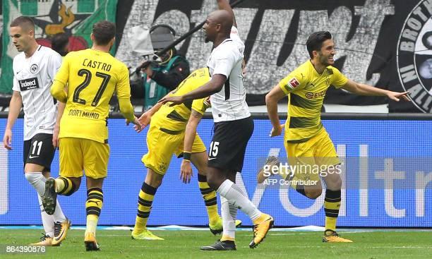 Dortmund's Turkish midfielder Nuri Sahin celebrates with his teammates after scoring the first goal during the German First division Bundesliga...