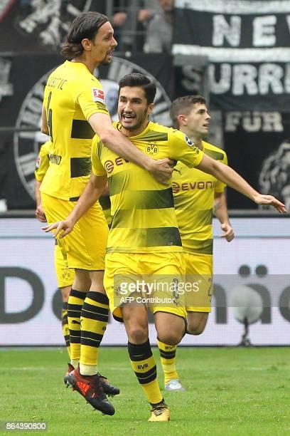 Dortmund's Turkish midfielder Nuri Sahin celebrates with teammates after scoring the first goal during the German First division Bundesliga football...