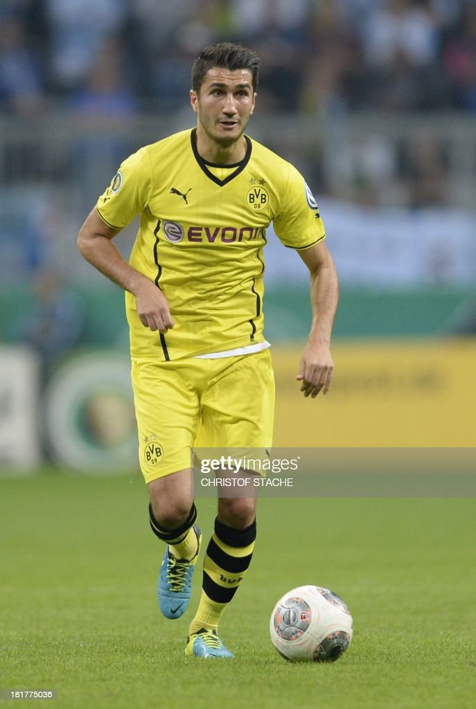 Dortmund's Turkish midfielder Nuri Sahin plays the ball during the second round football match of the German Cup (DFB - Pokal) TSV 1860 Munich vs Borussia Dortmund on September 24, 2013 in Munich, southern Germany. STACHE