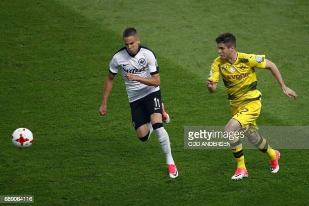 Dortmund's US midfielder Christian Pulisic and Frankfurt's Serbian midfielder Mijat Gacinovic vie for the ball during the German Cup final football...