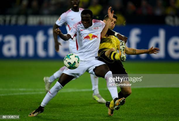 Dortmund's US midfielder Christian Pulisic and Leipzig's Guinean midfielder Naby Keita vie for the ball during the German first division Bundesliga...