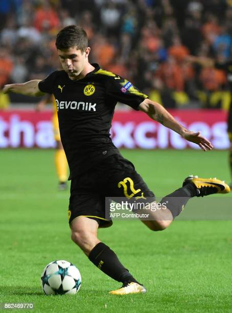 Dortmund's US midfielder Christian Pulisic attempts a cross during the UEFA Champions League football match between Apoel FC and Borussia Dortmund at...