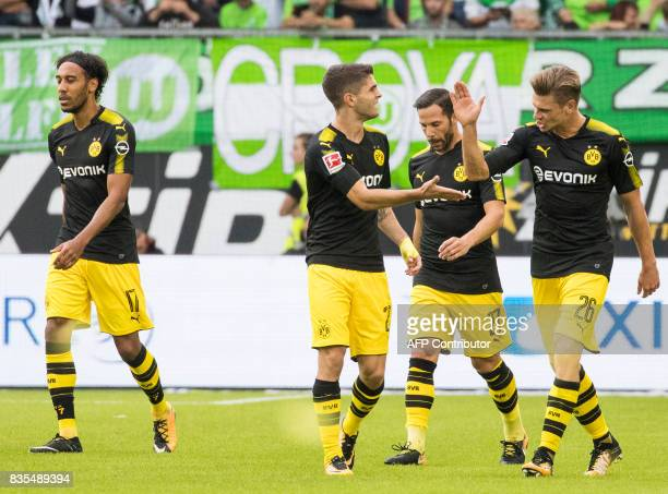 Dortmund's US midfielder Christian Pulisic celebrates scoring the opening goal with his team mates Polish defender Lukasz Piszczek and midfielder...