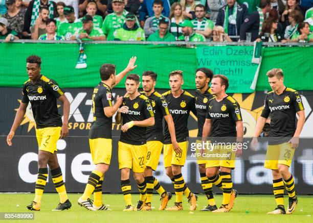 Dortmund's US midfielder Christian Pulisic celebrates scoring the opening goal with team mates during the German First division Bundesliga football...