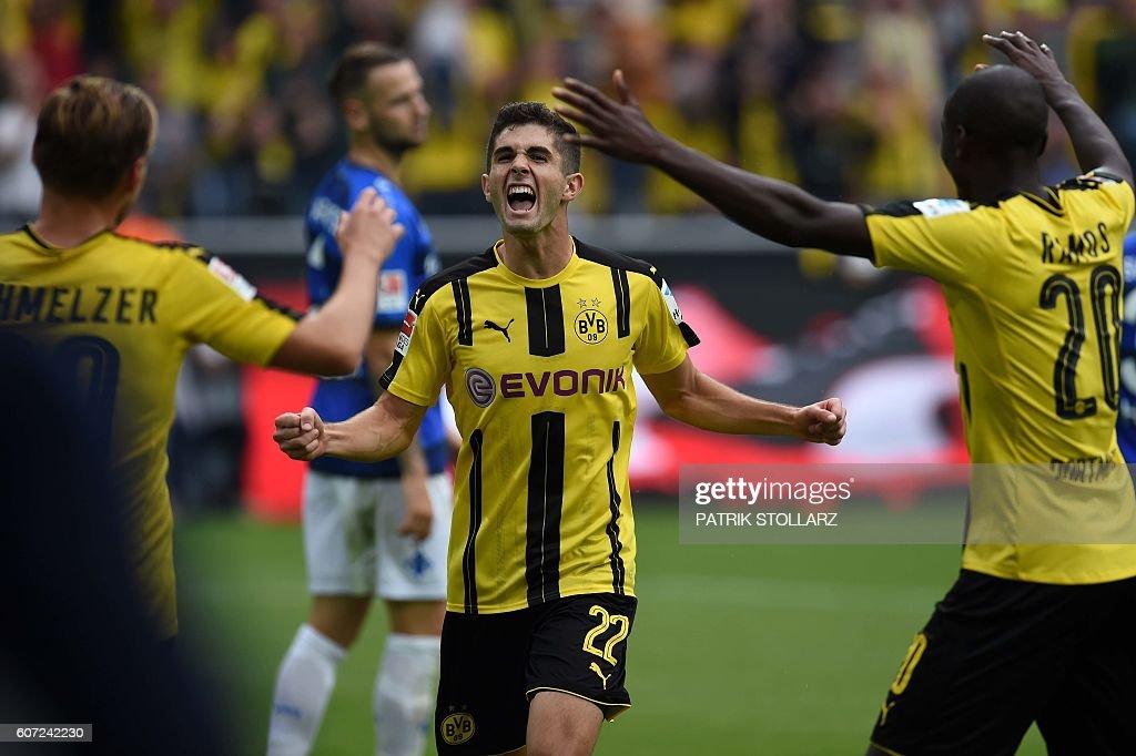 Dortmund's US midfielder Christian Pulisic (C) celebrates with team mates during the German first division Bundesliga football match of Borussia Dortmund vs SV Darmstadt 98 in Dortmund, western Germany, on September 17, 2016. / AFP / PATRIK
