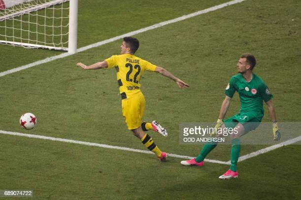 Dortmund's US midfielder Christian Pulisic is brought down by Frankfurt's Finnish goalkeeper Lukas Hradecky during the German Cup final football...