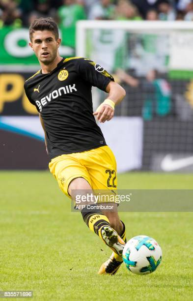 Dortmund's US midfielder Christian Pulisic plays a pass during the German first division Bundesliga football match Wolfsburg v Dortmund at the...