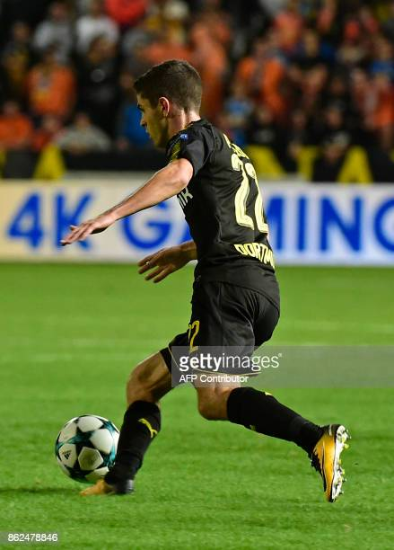 Dortmund's US midfielder Christian Pulisic runs with the ball during the UEFA Champions League football match between Apoel FC and Borussia Dortmund...
