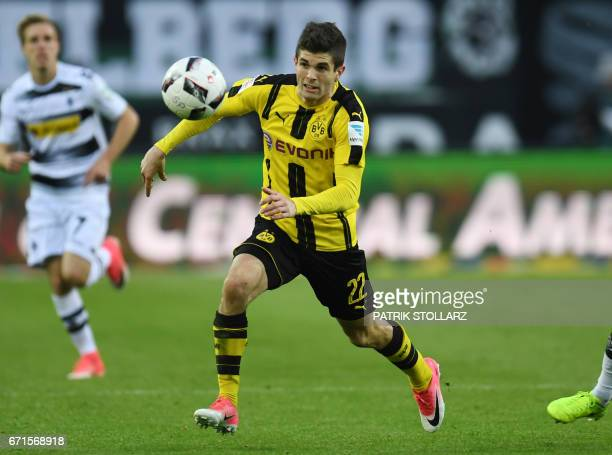 Dortmund's US midfielder Christian Pulisic vies for the ball during the German first division Bundesliga football match of Borussia Moenchengladbach...