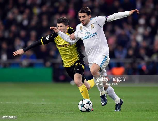 Dortmund's US midfielder Christian Pulisic vies with Real Madrid's Croatian midfielder Mateo Kovacic during the UEFA Champions League group H...