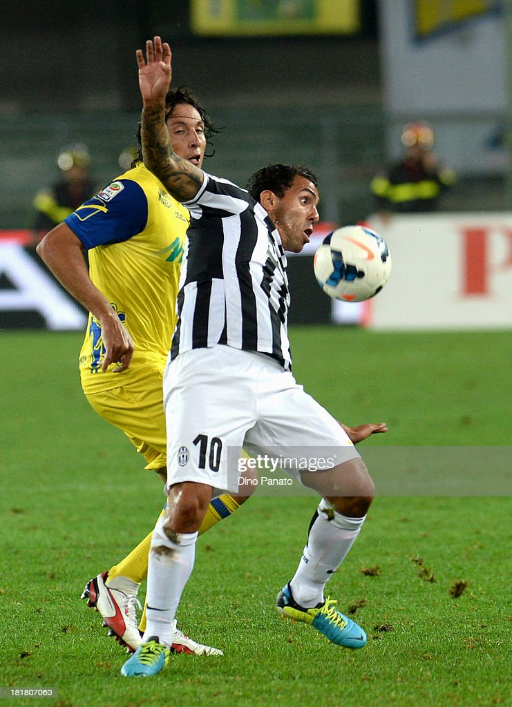 Dos Santos Claiton (L) of AC Chievo Verona competes with <a gi-track='captionPersonalityLinkClicked' href=/galleries/search?phrase=Carlos+Tevez&family=editorial&specificpeople=220555 ng-click='$event.stopPropagation()'>Carlos Tevez</a> of Juventus during the Serie A match between AC Chievo Verona and Juventus at Stadio Marc'Antonio Bentegodi on September 25, 2013 in Verona, Italy.