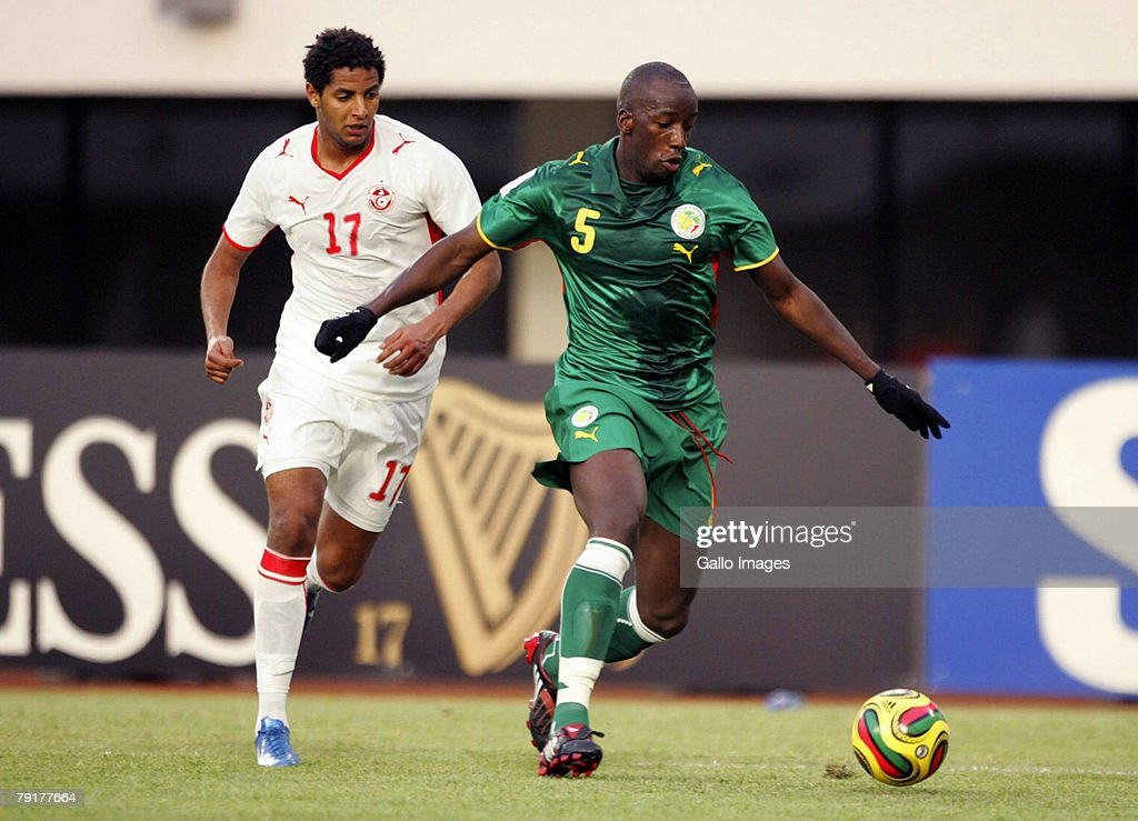 TAMALE, GHANA - JANUARY 23, Dos Santos of Tunisia and Souleymane Diawara of Senegal during the Group D AFCON match between Tunisia and Senegal held at the Tamale Stadium on January 23, 2008 in Tamale, Ghana.