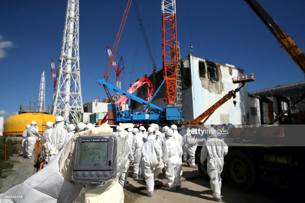 A dosimater displays 233 millisieverts per hour at Fukushima Daiichi Nuclear Power Plant fourth reactor building during the press tour on October 12, 2012 in Okuma, Fukushima, Japan.