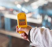Dosimeter measuring the radiation level. Inscriptions in Ukrainian with the dosimeter settings: level of gamma-doze, gamma-doze, real time, alarm-clock.