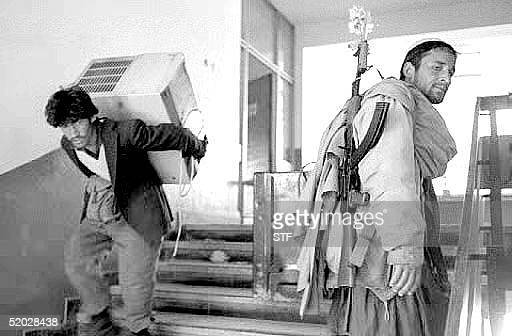 Dostam militiamen loot the Interior Ministry building 29 April 1992 one day after the mujahedeen interim council arrived from Pakistan