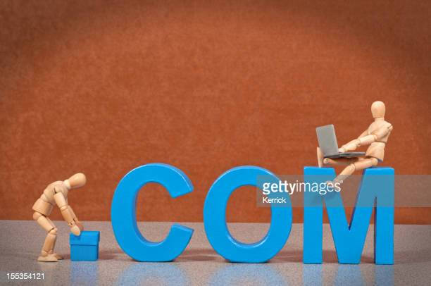 dot COM - Wooden Mannequin demonstrating this word