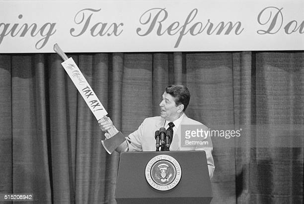 President Reagan glances at the official 'Tax ax' as he brings tax reform down home to this small southeastern Alabama town 7/10 Speaking at the...