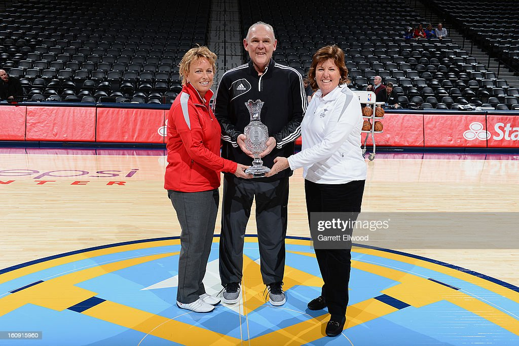 Dottie Pepper (left) and U.S. Team Captain Meg Mallon (right) take a picture with George Karl, Head Coach of the Denver Nuggets and the Solheim Cup, before the game against the Chicago Bulls on February 7, 2013 at the Pepsi Center in Denver, Colorado.