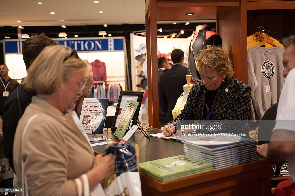 <a gi-track='captionPersonalityLinkClicked' href=/galleries/search?phrase=Dottie+Pepper&family=editorial&specificpeople=2351128 ng-click='$event.stopPropagation()'>Dottie Pepper</a> autographs books for fans in the PGA Golf Shop at the 60th PGA Merchandise Show on January 24, 2013 at The Orange County Convention Center in Orlando, Florida.