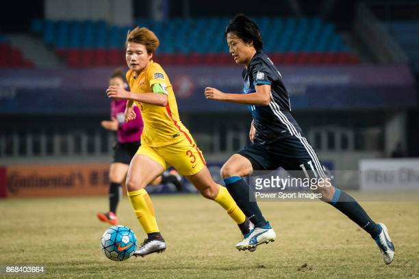 Dou Jiaxing of China fights for the ball with Saori Takarada of Japan during their AFC U19 Women'u2019s Championship 2017 SemiFinals match between...
