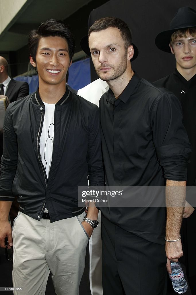 Dou Xiao and Kris Van Assche attend the Dior Homme Menswear Spring/Summer 2012 show as part of Paris Fashion Week at on June 25, 2011 in Paris, France.
