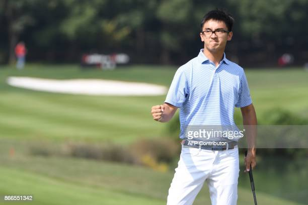 Dou Zecheng of China celebrates a birdie putt during the first round at the WGCHSBC Champions at the Sheshan International golf club in Shanghai on...