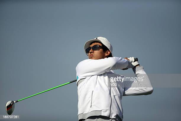 Dou Zecheng of China in action during the AsiaPacific Amateur Championship at Nanshan International Golf Club on October 24 2013 in Longkou China