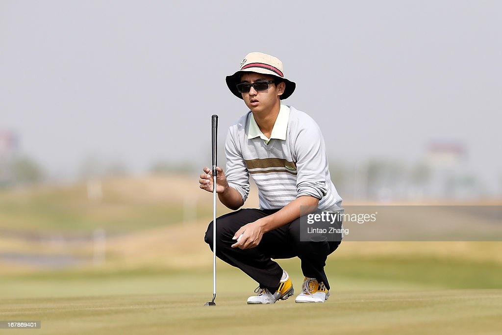 Dou Ze-cheng of China lines up a putt during the first day of the Volvo China Open at Binhai Lake Golf Course on May 2, 2013 in Tianjin, China.