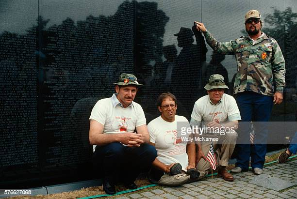 Double amputee Bob Wieland and other Vietnam veterans gather at the Vietnam Veterans Memorial where Wieland was speaking about the economic plight of...