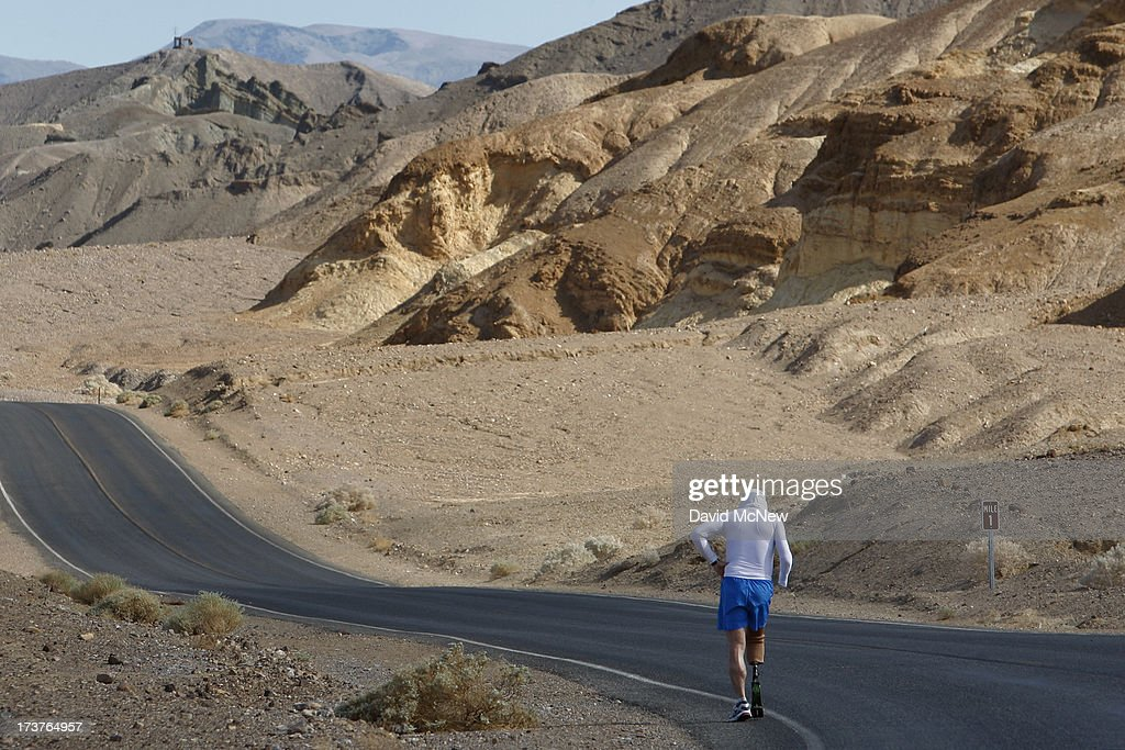 Double amputee Chris Moon of Great Britain runs in the AdventurCORPS Badwater 135 ultra-marathon race on July 15, 2013 in Death Valley National Park, California. Billed as the toughest footrace in the world, the 36th annual Badwater 135 starts at Badwater Basin in Death Valley, 280 feet below sea level, where athletes begin a 135-mile non-stop run over three mountain ranges in extreme mid-summer desert heat to finish at 8,350-foot near Mount Whitney for a total cumulative vertical ascent of 13,000 feet. July 10 marked the 100-year anniversary of the all-time hottest world record temperature of 134 degrees, set in Death Valley where the average high in July is 116. A total of 96 competitors from 22 nations are attempting the run which equals about five back-to-back marathons. Previous winners have completed all 135 miles in slightly less than 24 hours.