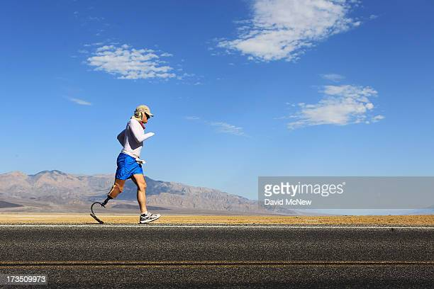 Double amputee Chris Moon of the UK runs in the AdventurCORPS Badwater 135 ultramarathon race on July 15 2013 in Death Valley National Park...