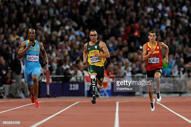 Double amputee Oscar Pistorius of South Africa competes in the Mens 400m semi final with Chris Brown and Jonathan Borlee as part of the 2012 London...