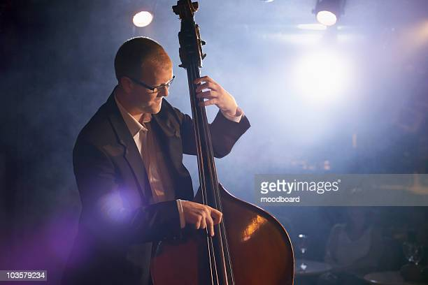 Double bass player on stage, portrait