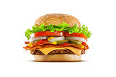 High resolution, digital capture of a double cheese cheeseburger with crispy bacon slices, American cheese, pickles, onions, tomatoes, lettuce, ketchup, and mustard, on a fresh sesame seed bun, set ag