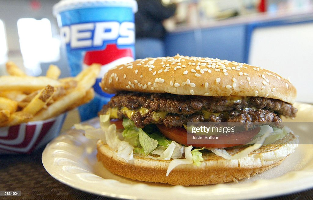 A double cheeseburger fries and soda lie on a table at Majors Hamburgers December 28 2003 in Yakima Washington Two farms have been quarantined in...