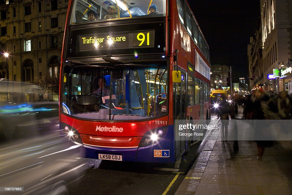 A double deck bus moves slowly along The Strand on December 6, 2012, in London, England. Central London captures the Christmas holiday spirit, with shops, museums, hotels and other major tourist attractions displaying festive decorations.