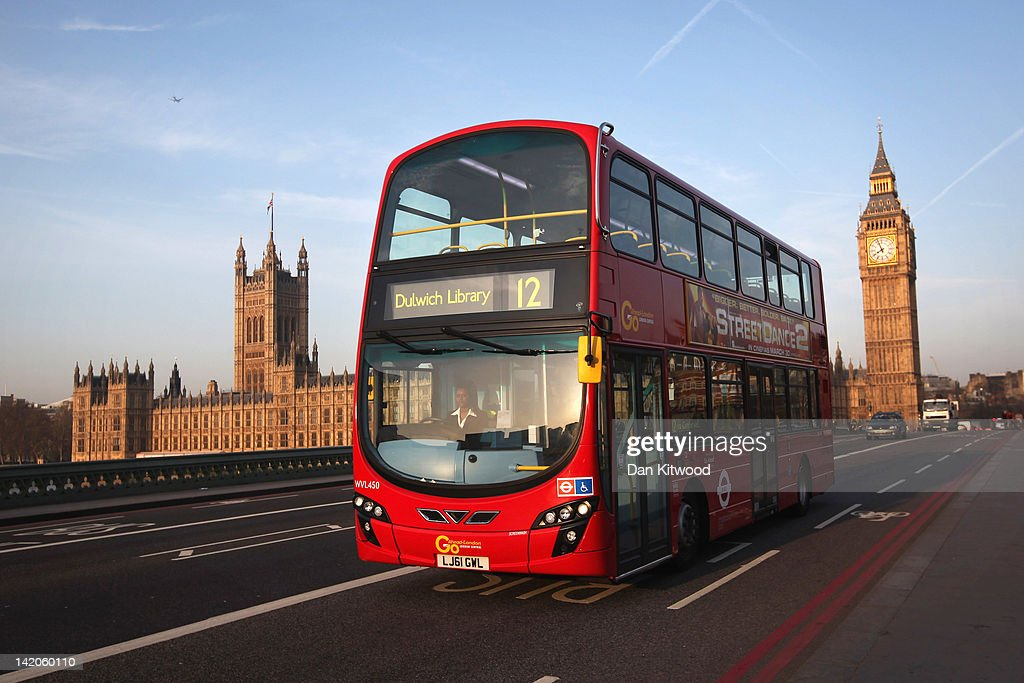 A double decker bus makes its way over Westminster Bridge, past the Houses of Parliament and Big Ben on March 28, 2012 in London, England.