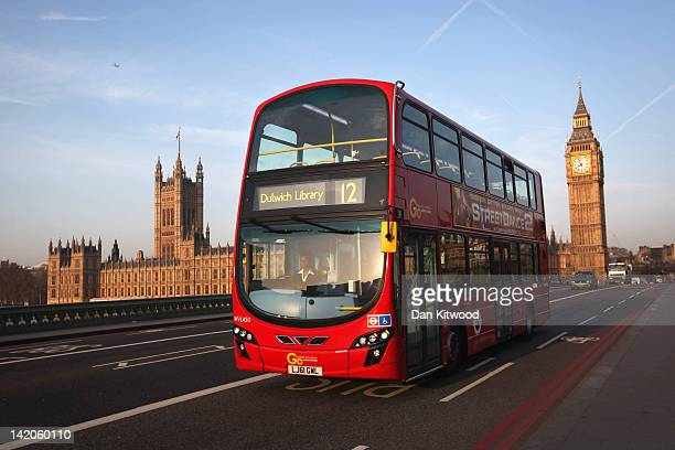 A double decker bus makes its way over Westminster Bridge past the Houses of Parliament and Big Ben on March 28 2012 in London England