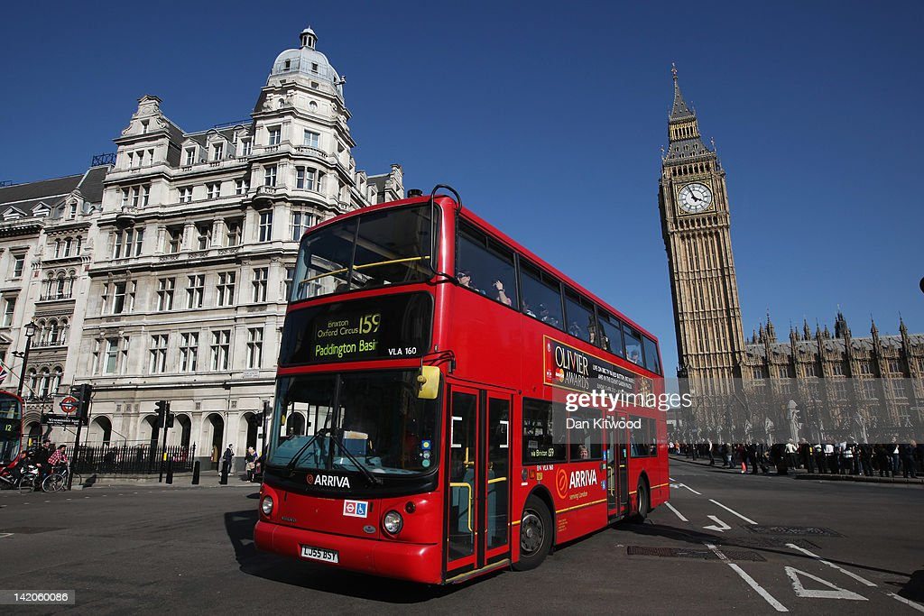 A double decker bus makes its way past the Houses of Parliament on March 27, 2012 in London, England.