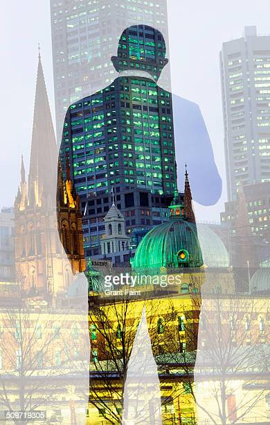 Double exposure: Businessman and city background.