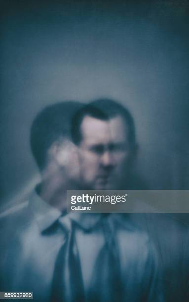 Double exposure businessman with two faces