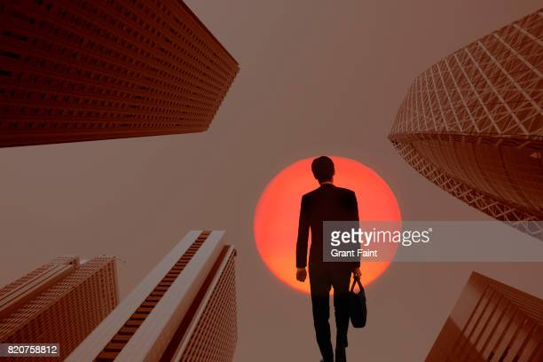 Double exposure city office towers and businessman.