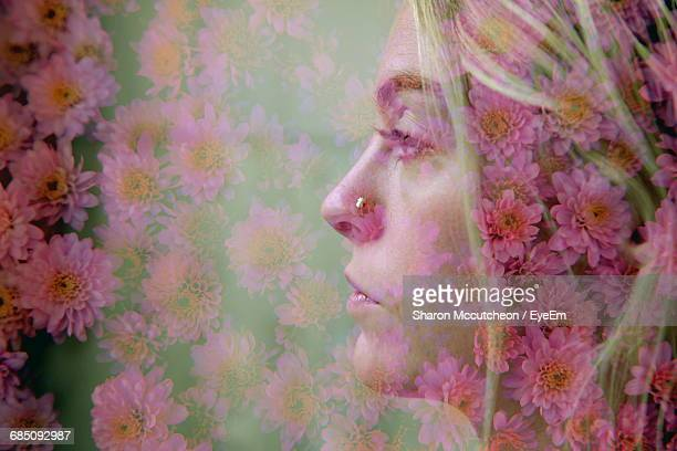 Double Exposure Headshot Of Young Woman And Flowers